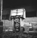 'Pump 1' a black & white photographic image of an old, disused petrol pump